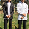 Senior Boys' Uniform: White Shirt and Pants Option. Jacket on and off