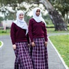 Senior Girls' School Uniform: Skirt and Jumper with White Scarf