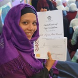 Ms Najma with her Teacher's Award